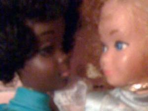 Close up of Black and White Barbies--look like they're about to kiss