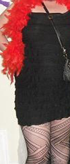 White skin, black dress, red boa, funky-ass tights